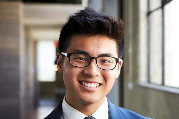 young-asian-businessman-smiling-to-camera-U7VL3Z8.jpg